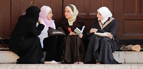 Group of young Muslim women talking in Omayad mosque courtyard , Damascus , Syria