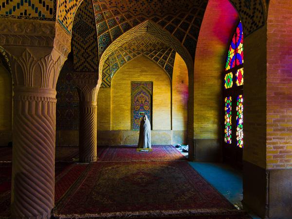 Woman in chador praying in Vakin mosque, Shiraz